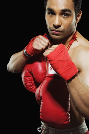 Male boxer in fighting stance Stock Photo - 10168305
