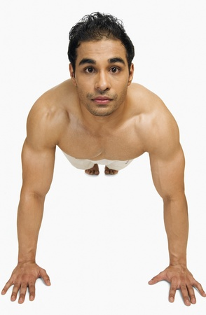 only the biceps: Portrait of a man doing push-ups