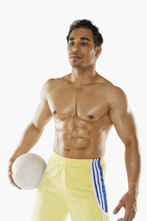 only the biceps: Man holding soccer ball
