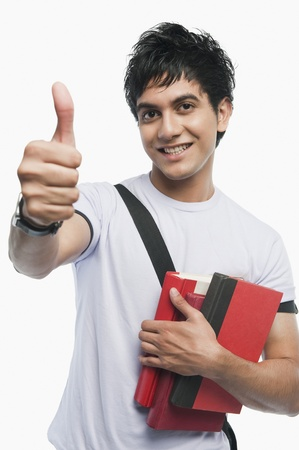 shoulder bag: Portrait of a college student showing thumbs up