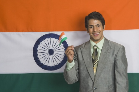 Portrait of a man holding Indian flag Stock Photo - 10167842