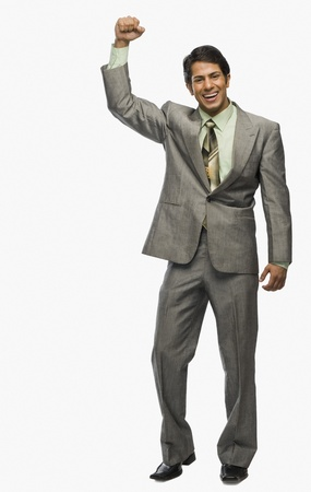 Businessman clenching fist in excitement Stock Photo - 10166992