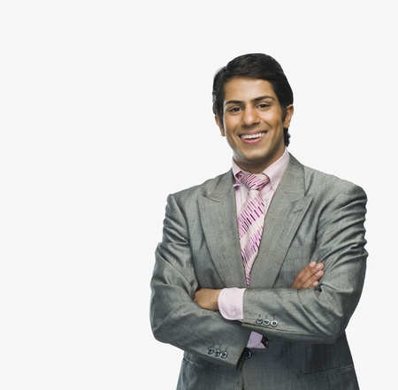 indian subcontinent ethnicity: Portrait of a businessman with arms crossed LANG_EVOIMAGES