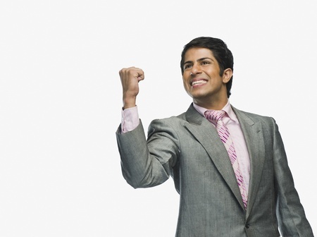 Businessman clenching fist in excitement Stock Photo - 10167477
