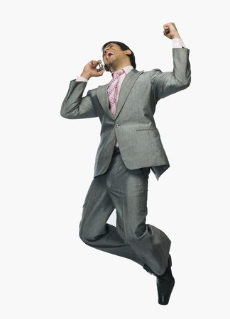 enthusiasm: Businessman talking on a mobile phone