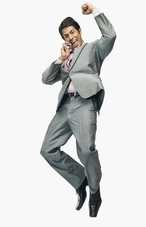 cheer full: Businessman talking on a mobile phone