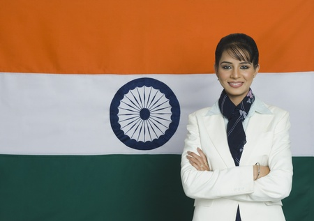 Portrait of a woman in front of an Indian flag Stock Photo - 10168393