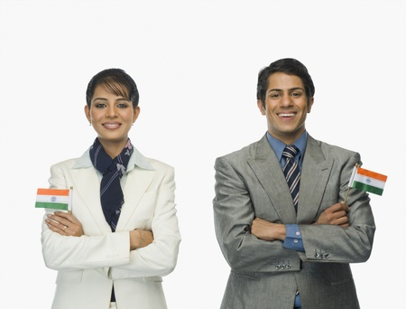 indian subcontinent ethnicity: Business executives holding Indian flags LANG_EVOIMAGES