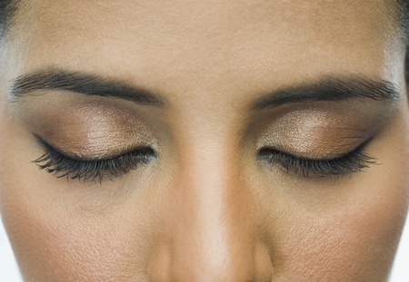 self conceit: Close-up of a woman with eye make-up