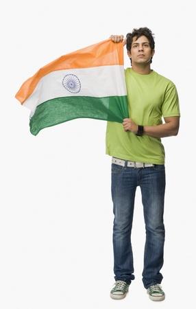 Man holding an Indian flag LANG_EVOIMAGES