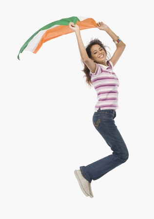 Portrait of a woman jumping with an Indian flag Standard-Bild