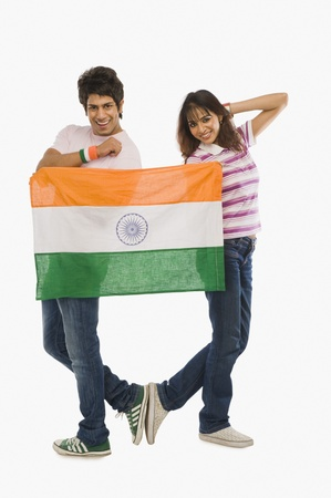 traditionally indian: Couple holding Indian flag