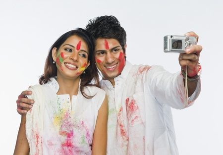 Couple taking a picture of themselves on Holi Stock Photo