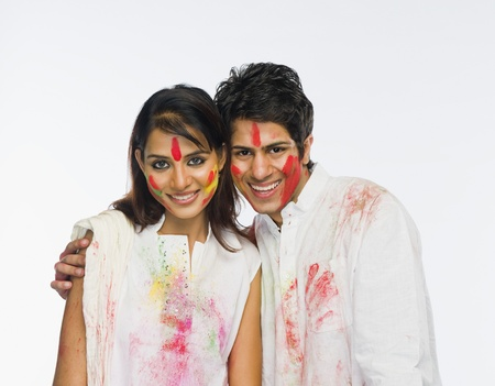 Portrait of a couple celebrating Holi