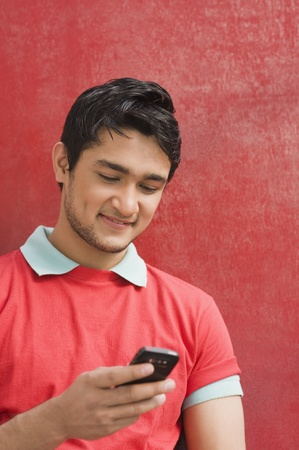 Man text messaging on a mobile phone Stock Photo