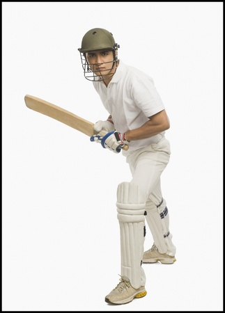 batsman: Cricket batsman playing a defensive stroke