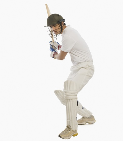 Cricket batsman playing a stroke Stock Photo - 10166728