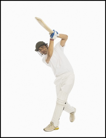 Cricket batsman playing a straight drive Stock Photo - 10169021