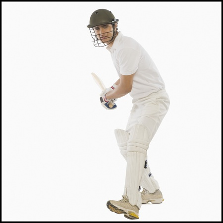 Cricket batsman with a high back lift Stock Photo - 10169002