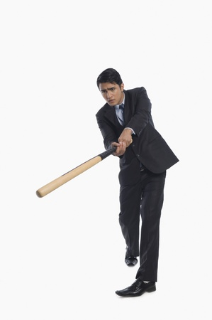 Businessman playing baseball