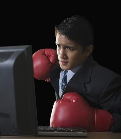 technophobe: Businessman punching a desktop pc