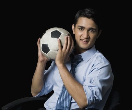 only adult: Businessman holding a soccer ball