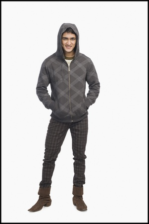 hooded shirt: Man wearing a hooded shirt and smiling