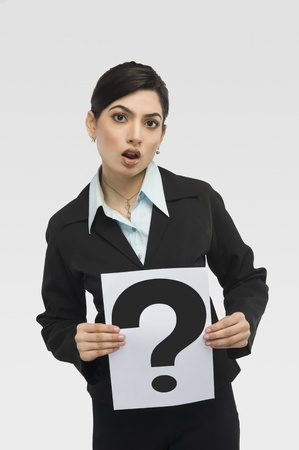 Businesswoman holding a card with question mark Stock fotó