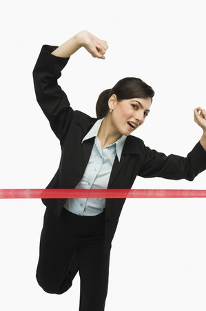 Businesswoman crossing the finishing line Stock Photo - 10168913