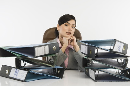 Stack of ring binders in front of a businesswoman Stock Photo - 10168251