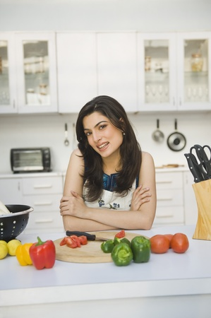 Portrait of a woman leaning on a kitchen counter Stock Photo - 10168558