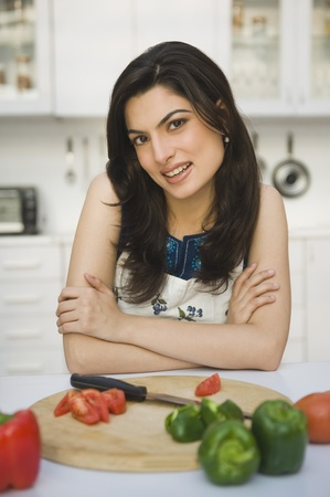 kitchen counter: Portrait of a woman leaning on a kitchen counter