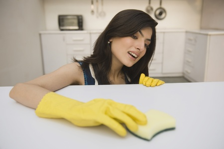 rubber: Woman cleaning a kitchen counter