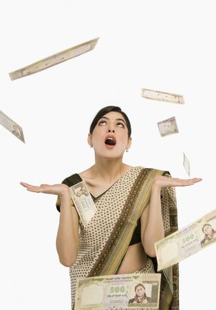 Money falling over a woman Standard-Bild