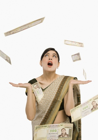 Money falling over a woman Stock Photo - 10168559