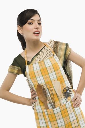 Housewife wearing an apron Stock fotó