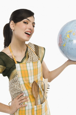 Woman holding a globe Stock Photo - 10167985