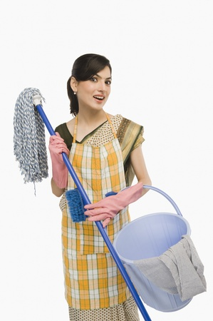 Woman holding a mop and a bucket Stock Photo