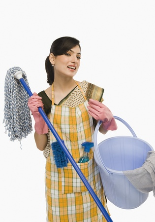 Woman holding a mop and a bucket Фото со стока