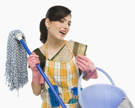 Woman holding a mop and a bucket Stock fotó