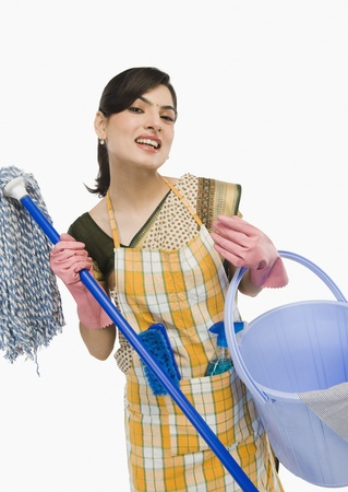 Woman holding a mop and a bucket Stok Fotoğraf