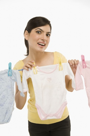 Woman hanging clothes on a clothesline Stock Photo - 10167021