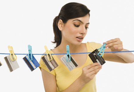Woman hanging credit cards on a clothesline