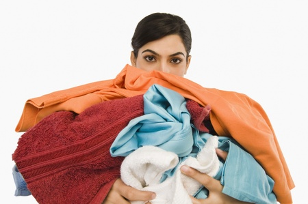 Woman holding clothes Stock Photo - 10167542