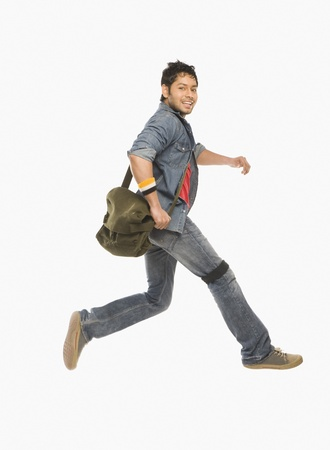 University student running with a shoulder bag