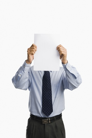 Businessman showing a sheet of blank paper
