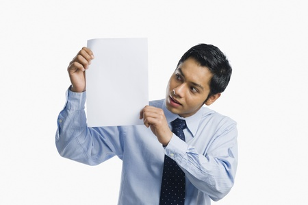 one sheet: Businessman showing a sheet of blank paper