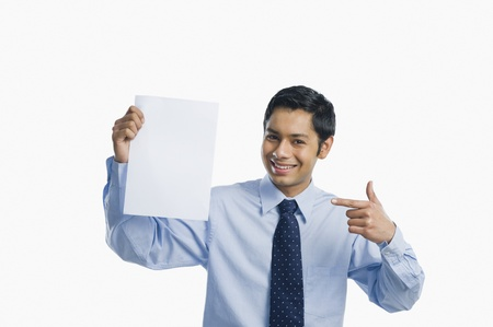 Businessman showing a sheet of blank paper Stock Photo - 10166971