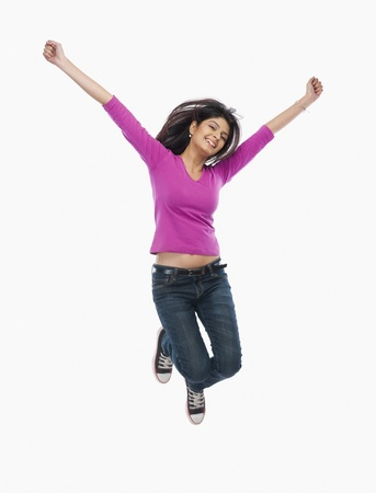 Close-up of a woman jumping Stock Photo