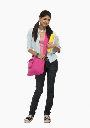 Female university student holding books and smiling Stock Photo - 10166748